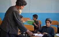 Afghan children attend their class at a school at Babro village in Arghandab district. Picture: AFP