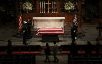 The flag-draped casket of former US President George HW Bush sits in repose inside of St. Martins Episcopal Church on 5 December, 2018 in Houston, Texas. Picture: AFP