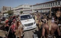 Mourners make way for the hearse in front of the morgue in Johannesburg on 5 May 2021 while they gather to pay their last respects to Queen Mantfombi Dlamini Zulu who died on 29 April 2021. Picture: Luca Sola/AFP