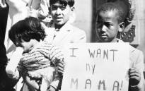 A black child demonstrates to have his mother released in May 1960 in front of Johannesburg's city hall. In the preceding weeks, more than 500 black South Africans were arrested after the Sharpeville massacre. Picture: AFP.