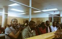 The six men accused of murdering ANC councillor Musawenkosi Mchunu in the dock at the Pietermaritzburg Magistrates Court. Picture: Ziyanda Ngcobo/EWN.