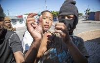 A Parkwood residents holds up a rubber bullet used to disperse angry protesters who clashed with police over evictions. Picture: Thomas Holder/EWN