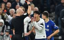 Referee Anthony Taylor (L) shows a red card to Tottenham Hotspur's Son Heung-Min during the English Premier League football match between Tottenham Hotspur and Chelsea at Tottenham Hotspur Stadium in London, on 22 December 2019. Picture: AFP