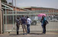 FILE: Families stand outside the Germiston mortuary, waiting for the bodies of their loved ones to be released, as an ongoing strike prevents operations. Picture: Thomas Holder/EWN