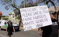 A Black Monday demonstrator holds up a poster, pleading for help from US President Donald Trump. Picture: Thomas Holder/EWN