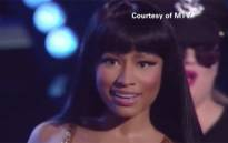 Nicki Minaj confronts Miley Cyrus on stage at the MVAs after accepting her award. Picture:CNN/screengrab