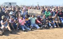 Hundreds of Zwelihle residents gathered at the sports ground where Police Minister Bheki Cele addressed them. Picture: Monique Mortlock/EWN