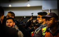 Barcelona FC stars Lionel Messi and Luis Suárez arrive at Johannesburg's OR Tambo International Airport ahead of their friendly match against Mamelodi Sundowns on 16 May 2018. Picture: Kayleen Morgan/EWN