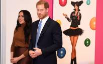 Britain's Prince Harry, Duke of Sussex and Meghan, Duchess of Sussex react as they view a special exhibition of art by Indigenous Canadian artist, Skawennati, in the Canada Gallery during their visit to Canada House, in London on 7 January 2020, to give thanks for the warm Canadian hospitality and support they received during their recent stay in Canada. Picture: AFP