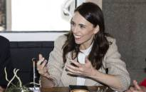 New Zealand Prime Minister Jacinda Ardern speaks with senior members of parliament a day after her landslide election win, in Auckland on 18 October 2020. Picture: AFP