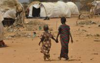 This file photo taken on 10 July 2011 shows newly arrived Somali refugees walking to a registration centre at the Daadab refugee camp on 10 July 2011 in northeastern Kenya. Picture: AFP.