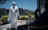 FILE: A laboratory specialist wearing protective gear outside the Infectious Disease Unit of Kenyatta National Hospital in Nairobi, Kenya, on 15 March 2020. Picture: AFP