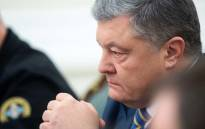 FILE: This handout picture taken and released by the Ukrainian Presidential press service shows President of Ukraine Petro Poroshenko leading a session of the National Security and Defense Council of Ukraine in Kiev early on 26 November 2018, following an incident in the Black Sea off Moscow-annexed Crimea. Picture: AFP
