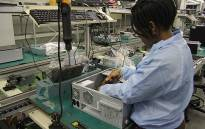 FILE: Computer factory worker. Picture: EWN