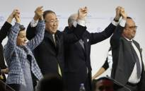 FILE: (L-R) Executive Secretary of the United Nations Framework Convention on Climate Change (UNFCCC) Christiana Figueres, Secretary General of the United Nations Ban Ki Moon, Foreign Affairs Minister and President-designate of COP21 Laurent Fabius, and France's President Francois Hollande raise hands together after adoption of a historic global warming pact at the COP21 Climate Conference in Le Bourget, north of Paris, on December 12, 2015. Envoys from 195 nations on December 12 adopted to cheers and tears a historic accord to stop global warming. Picture: AFP