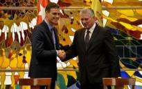 Cuba's President Miguel Diaz-Canel (R) and Spain's Prime Minister Pedro Sanchez shake hands after signing bilateral agreements during a ceremony at Revolution Palace in Havana, on 22 November 2018. Sanchez' two-day official visit to Cuba is the first in over 30 years by a Spanish PM to the island nation. Picture: AFP