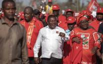 Mozambican ruling Party FRELIMO Presidential Candidate and Incumbent Mozambican President Filipe Nyusi (C) gestures as he arrives to attend his party's last Mozambican General Election campaign rally on 12 October 2019 in Matola, Mozambique. Mozambique general elections will take place on 15 October 2019.