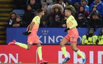 Manchester City's Brazilian striker Gabriel Jesus (R) celebrates with Manchester City's Algerian midfielder Riyad Mahrez after he scores his team's first goal during the English Premier League football match between Leicester City and Manchester City at King Power Stadium in Leicester, central England on 22 February 2020. Picture: AFP