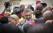 FILE: Security personnel crowd around Stellenbosch University's Vice Chancellor Wim de Villiers. Picture: Thomas Holder/EWN