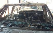 Vehicle belonging to a taxi owner in Zola, Soweto was set alight allegedly by taxi drivers. The taxi owner's wife says their four children were still in the car when drivers set the vehicle alight. Picture: Mia Lindeque/EWN.