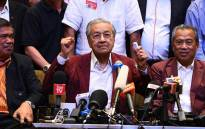 FILE: Malaysian prime minister Mahathir Mohamad celebrates with other leaders of his coalition during a press conference in Kuala Lumpur on 10 May 2018. Picture: AFP.