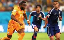 FILE: Didier Drogba of the Ivory Coast controls the ball against Keisuke Honda of Japan during their Group C match against Japan at Arena Pernambuco, 14 June 2014, Recife, Brazil. Picture: Fifa.