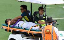 Sri Lanka opener Dimuth Karunaratne is taken off the field after being struck by the ball during day two of the second Test against Australia in Canberra on 2 February 2019.Picture: AFP
