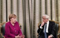 German Chancellor Angela Merkel (L) chats with Greek President Prokopis Pavlopoulos during their meeting in Athens on 11 January 2019. Picture: AFP