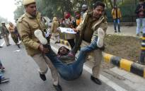 A protester is detained by police at a demonstration against India's new citizenship law in New Delhi on 27 December 2019. Picture: AFP