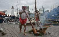 FILE: Australian aboriginal elders perform a smoking ceremony to welcome members of the Polynesian Voyaging Society on the voyaging canoe Hōkūleʻa on its 47,000 nautical mile journey over four years to engage a global community in creating a healthy and sustainable planet in Sydney on 19 May 2015. Picture: AFP