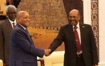 Sudanese President Omar al-Bashir (R) shakes hands with South African President Jacob Zuma during a meeting on 1 February 1, 2015 in the capital Khartoum. Zuma arrived for an official two-day visit in Khartoum the day before to discuss bilateral cooperation as well as socio-economic development and peace and security issues on the continent. Picture: AFP.
