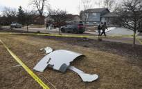 Pieces of an airplane engine from Flight 328 sit scattered in a neighborhood on 20 February 2021 in Broomfield, Colorado. Picture: AFP