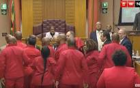 EFF MPs are thrown out during Pravin Gordhan's Public Enterprises budget vote. Picture: EWN YouTube.