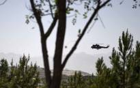A US military helicopter is seen flying towards the Green Zone in Kabul on 3 August 2019, as new talks between the US and the Taliban continue. Washington is hoping for a breakthrough as talks between the US and the Taliban resumed in Doha on 3 August in a bid to end 18 years of war in Afghanistan. Picture: AFP