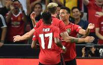 Manchester United's Mason Greenwood (back R) is congratulated by teammates after scoring during the International Champions Cup football match between Manchester United and Inter Milan in Singapore on 20 July 2019. Picture: AFP.