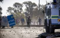 Protesters from Sicelo informal settlement, Meyerton, in the Midvaal hurl stones at an Nyala during a service delivery protest. Picture: Thomas Holder/EWN