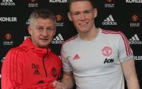 Manchester United caretaker boss Ole Gunnar Solskjaer pictured with Scott McTominay. Picture: @ManUtd/Twitter