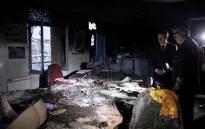 "President Emmanuel Macron inspects damage after ""yellow vest"" protest. Picture: @EmmanuelMacron/Twitter."