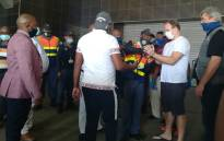 Gerard Jansen Van Vuuren is handcuffed by police at Johannesburg International Airport after being extradited from Brazil to stand trial for allegedly stabbing his ex-girlfriend to death in Johannesburg in 2011. Picture: SAPS.