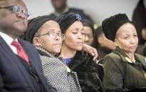 Gugu Zulu's widow Letshego is comforted by her mother while Zulu's mother Puleng (Far Right) sits alongside at his memorial at Kyalami race track. Picture: Thomas Holder/EWN