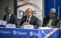 Chief Executive of Eskom Phakamani Hadebe, Public Enterprises Minister Pravin Gordhan and Eskom chairperson Jabu Mabuza at a press briefing at Lethabo power station. Picture: Abigail Javier/EWN
