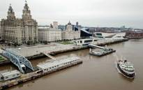 FILE: This aerial view taken in Liverpool, northwest England on 2 October 2020, shows a Mersey Ferry pulling away from Pier Head, near the Liver Building, as it travels on the River Mersey. Picture: Paul Ellis/AFP