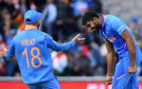 India's Vijay Shankar celebrates with India's captain Virat Kohli after the dismissal of Pakistan's Imam-ul-Haq during the 2019 Cricket World Cup group stage match between India and Pakistan at Old Trafford in Manchester, northwest England, on 16 June, 2019. Picture: AFP.