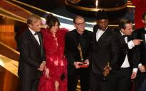 Cast members of 'Green Book' with US actor Viggo Mortensen (L), Linda Cardellini (2nd L) and US actor Mahershala Ali (R) celebrate the Best Picture award onstage during the 91st Annual Academy Awards at the Dolby Theatre in Hollywood, California on 24 February 2019. Picture: AFP