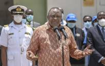 Kenya's President Uhuru Kenyatta (C) gives an address following his tour of the Nairobi National Vaccine Depot where the country's first batch of COVID-19 vaccines are preserved in cold storage in Nairobi on 4 March 2021. Picture: AFP