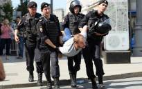 Police officers detain a man during an unauthorised rally demanding independent and opposition candidates be allowed to run for office in the local election in September, outside the mayor's offices in Moscow on 27 July 2019. Picture: AFP