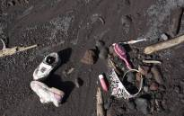 Toys and shoes are seen in the ash-covered village of San Miguel Los Lotes, in Escuintla Department, about 35 km southwest of Guatemala City, on 11 June, 2018. Picture: AFP.