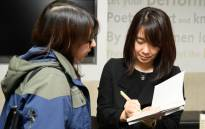 Korean author Han Kang signs a copy of her book The Vegetarian at a photocall in London on 15 May, 2016, ahead of tomorrow's announcement of the winner of the 2016 Man Booker International Prize. Picture: AFP.