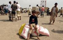 Displaced Yemenis receive food aid donated by a British organisation in Yemen's western province of Hodeida on 9 February 2021. Picture: Khaled Ziad/AFP