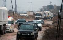 A convoy of aid vehicles drives in Syria's Idlib province as they head to the government-controlled towns of Fuaa and Kafraya to deliver aid on 11 January. 2016. Picture: AFP.